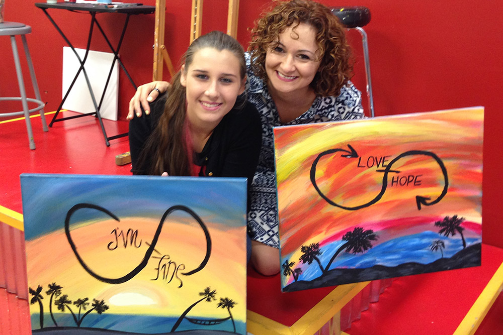 mentee and mentor at painting class