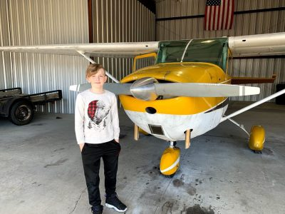 amachi boy standing with airplane